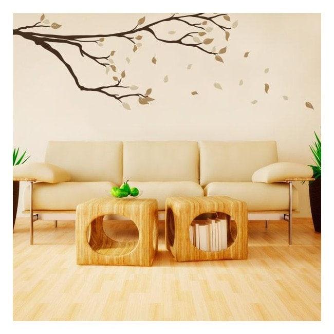 Branche de vinyle avec des feuilles dans le vent