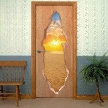 Coucher du soleil de vinyle de portes sur la plage