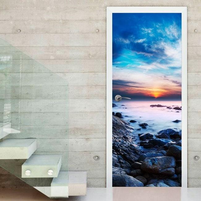 Coucher du soleil de portes de vinyle décoratif dans le lagon
