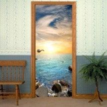 Vinyle décoratif porte soleil couchant sur la mer