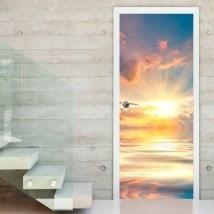 Vinyle porte soleil couchant sur la mer