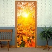 Vinyle pour les portes au coucher du soleil en automne