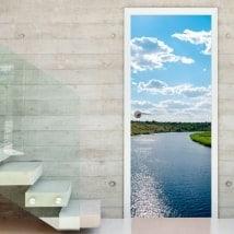 Vinyle pour portes coucher de soleil sur la rivière