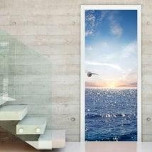 Vinyle et autocollants portes coucher de soleil dans la mer