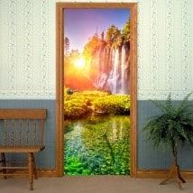 Vinyle décoratif de portes coucher du soleil dans les cascades