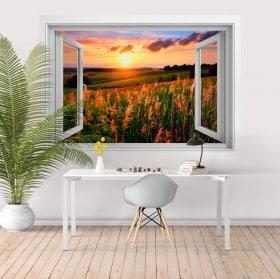 Autocollants pour mur fenêtre coucher de soleil dans le champ 3D
