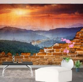Photo murales coucher de soleil dans les montagnes mur cassé