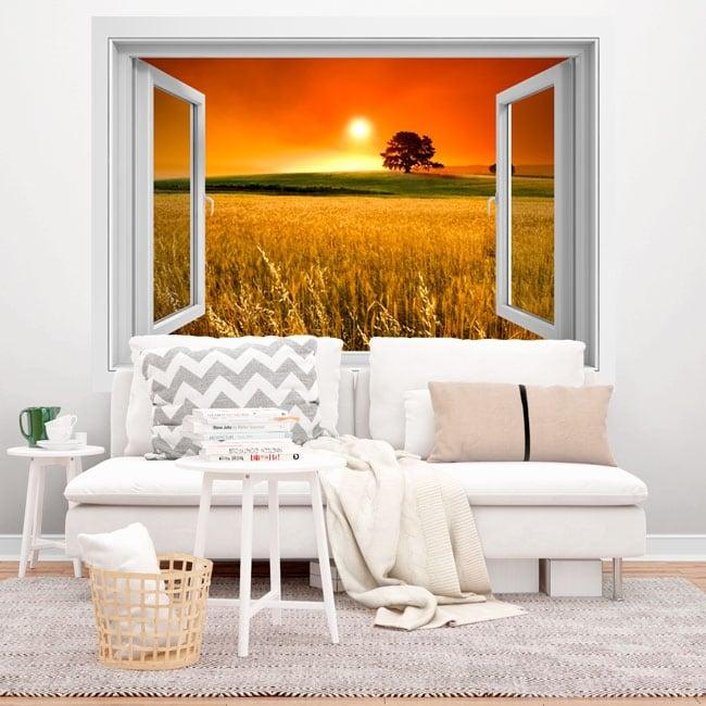 Vinyle fenêtre arbres dans le champ au coucher du soleil 3d