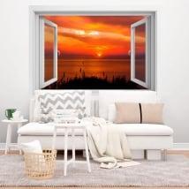 Vinyle décoratif fenêtres coucher du soleil 3d
